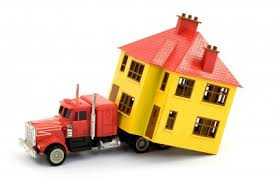 truck pulling house