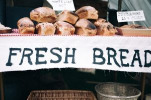 Bread above the sign 'fresh bread'.