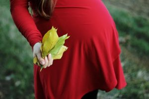 pregnant women holding a leaf