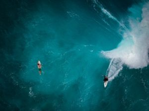 people swimming in the ocean at one of the top Hawaii locations for couples