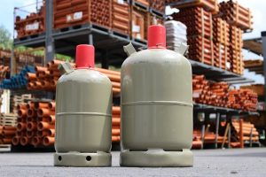 Two greyish propane tanks