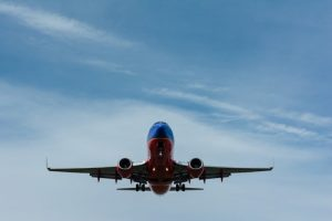 plane flying in the sky carrying goods as a part of air freight transport