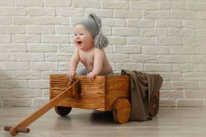 Baby in a cart smiling
